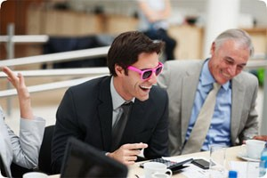 Executive wearing pink framed sunglasses to a meeting